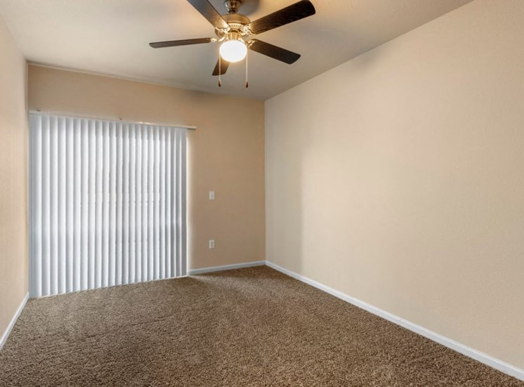 Living room with wall to wall carpet and ceiling fan